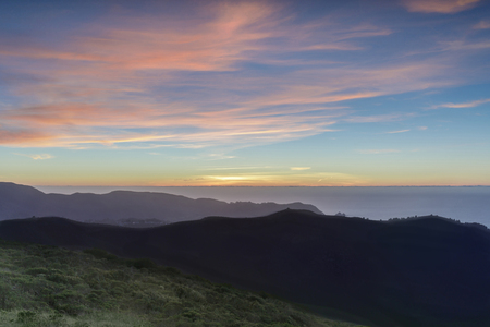 Sunset views of Sweeney Ridge top and the Pacific Ocean. Sweeney Ridge, Pacifica and San Bruno, San Mateo County, California, USA. Stock Photo