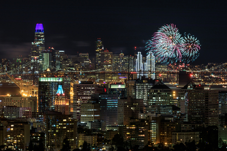 Oakland and San Francisco Downtowns with New Year's Eve 2019 Fireworks. Oakland Hills, Alameda County, California, USA.