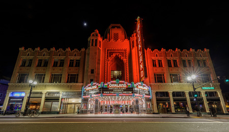 April 12, 2019 - Oakland, California: Fox Oakland Theatre at night with a crescent moon. The Fox Oakland Theatre is a 2,800-seat concert hall, a former movie theater, located in Downtown Oakland.