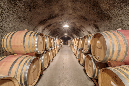 Calistoga, California - April 27, 2019: Cask storage in underground wine cellar in Castello di Amorosa. 13th-century–style winery offering guided tours of the castle & tastings of Italian-inspi