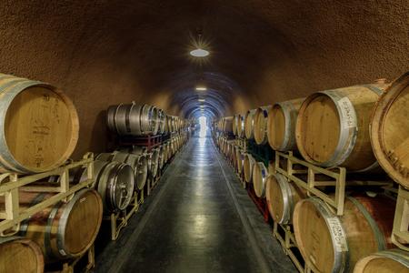 Kenwood, California - April 28, 2019: Cask storage in underground wine cellar in Deerfield Ranch Winery in Sonoma Valley. Kenwood, Sonoma County, California, USA. Redakční