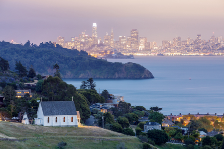 Scenic views of Old St Hillary's Church, Angle Island, Alcatraz Prison, San Francisco Bay and San Francisco Skyline at dusk. Shot from Tiburon, Marin County, California, USA. 写真素材 - 122423982