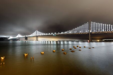 Panoramic view of the Bay Bridge from the Port of San Francisco. The Embarcadero, San Francisco, California, USA. Reklamní fotografie