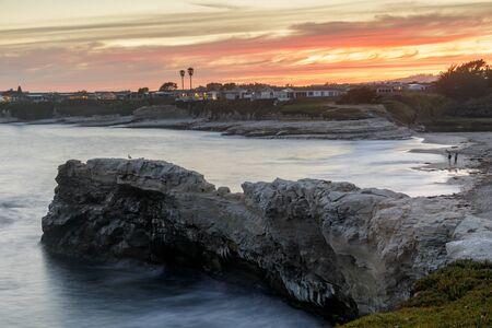 Summer sunset above Natural Bridges State Beach. Santa Cruz, California, USA.