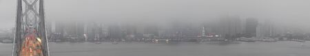 Bridge Traffic in Fog City. Panoramic views of the Bay Bridge and San Francisco waterfront from Yerba Buena Island on 4th of July evening.