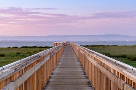 Twilight over the new boardwalk at Baylands Nature Preserve. Palo Alto, Santa Clara County, California, USA. Reklamní fotografie
