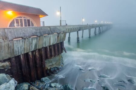 Pacifica Municipal Pier in Thick Fog and High Tide. Pacifica, San Mateo County, California, USA.