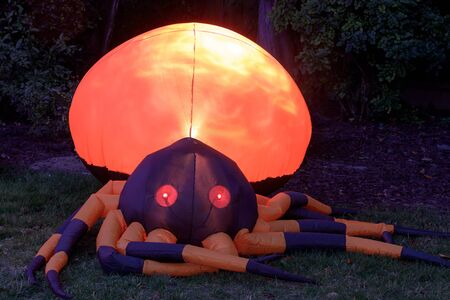 Inflatable Giant Spider Glowing in the Dark. Blown up spider outside front yard in October for Halloween decor.