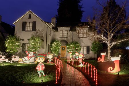 Christmas d??cor on a house in Christmas Tree Lane. Palo Alto, California, USA. Stock Photo