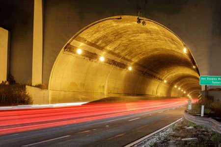 MacArthur Tunnel Traffic. Car Light Trails entering Presidio Tunnel (AKA MacArthur Tunnel) in San Francisco Stock fotó
