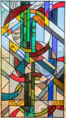 Stained Glass Window Panel of Yin Yang Circles. Abstract Geometric Yin Yang Leaded Stained Glass Panel Hanging over a Window.