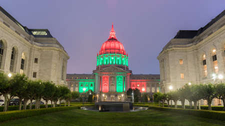 San Francisco City Hall lit in Red, Green, and Black, via the Memorial Court