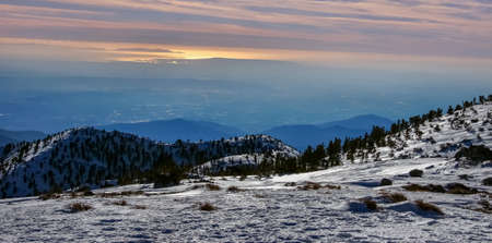 Sunset views of Angeles National Forest from Mt Baldy Summit, AKA Mt San Antonio, the highest point in San Gabriel Mountains of San Bernardino County in Southern California