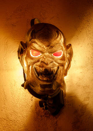 Demonic Face Light Fixture Decorating House Exterior for Halloween 写真素材