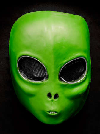 El Wire Alien Face Mask Isolated Against Black Background