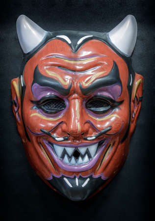 Vintage Devil Face Mask Isolated Against Black Background Фото со стока