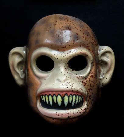 Evil Monkey Mask Isolated Against Black Background