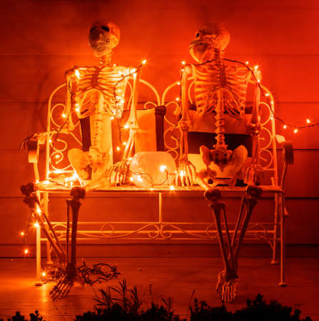 Skeletons Hanging Out Wearing Face Coverings during Covid-19 Pandemic on Halloween 2020 Фото со стока