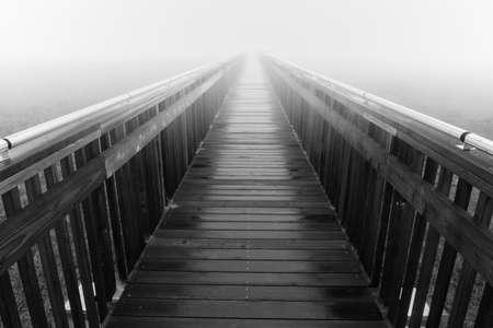Baylands Nature Preserve Boardwalk in Thick Morning Fog. Palo Alto, Santa Clara County, California, USA.