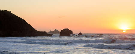 Sun setting over Rockaway Beach in Pacifica, California