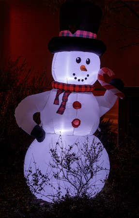 Inflated Snowman Glowing in the dark during Christmas Season