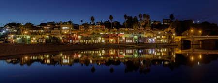 Panoramic Capitola Village and Water Reflections during Blue Hour. Capitola, Santa Cruz County, California, USA.