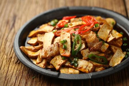 sizzling: sizzling dried tofu Stock Photo