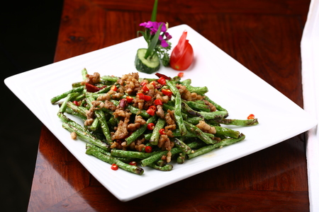 long beans: Stir fried long beans with spicy pork Stock Photo