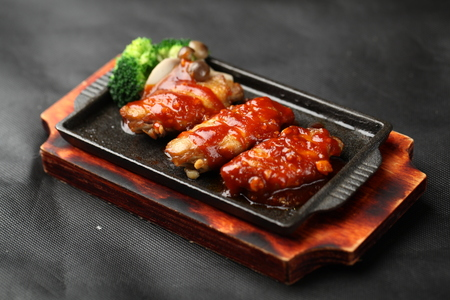 sizzling: Tasty grilled meat on sizzling plate Stock Photo
