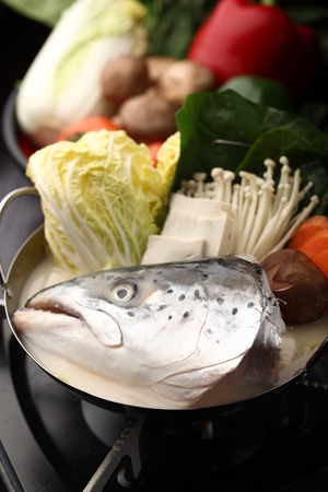 fish head: Fish head and vegetables cook in a wok