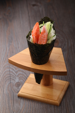 california roll: California roll on a sushi stand