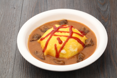 an omelette: Omelette with meat curry