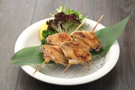 barbecued: Barbecued chicken on sticks served on a plate