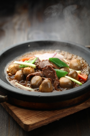 sizzling: Chinese cuisine served on a sizzling plate Stock Photo