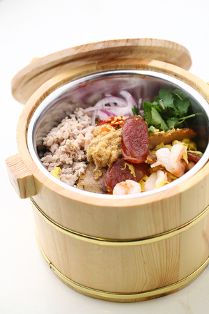 asian cuisine: Asian cuisine in a wooden thermal food storage