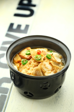 bean curd: bean curd skin with soup served in a pot Stock Photo