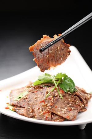 stir fried: Stir fried spicy meat served on a plate Stock Photo