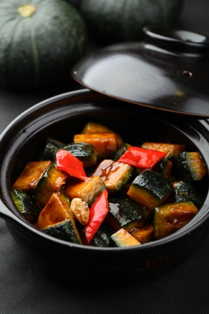 clay pot: Pumpkin and bell peppers served in a clay pot bowl