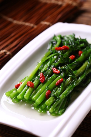 chinese spinach: Chinese spinach with goji berry served on a plate Stock Photo