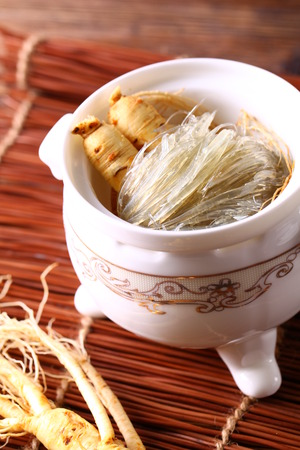 ginseng roots: Herbal soup served in a bowl