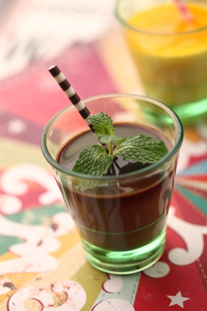 shot glass: Chocolate dessert in a shot glass with a biscuit stick Stock Photo
