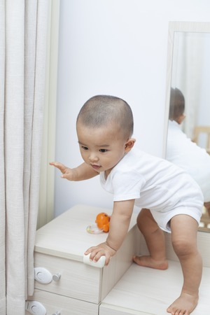 looking at baby: Chinese baby boy playing on a dressing table, shot in Beijing, China