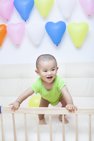 happy baby: Chinese baby boy and colorful balloons, shot in Beijing, China Stock Photo
