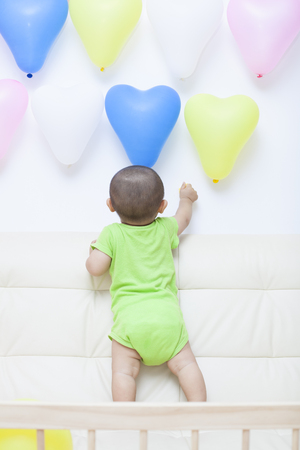 baby boy: Chinese baby boy and colorful balloons, shot in Beijing, China Stock Photo