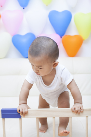 cute boys: Chinese baby boy and colorful balloons, shot in Beijing, China Stock Photo