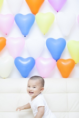 oriental ethnicity: Chinese baby boy and colorful balloons, shot in Beijing, China Stock Photo