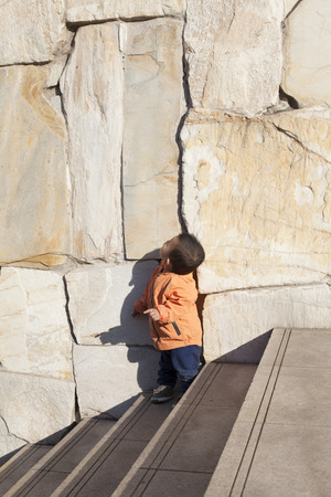 12 18 months: Cute Chinese baby boy playing on stairs, shot in Beijing, China Stock Photo