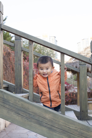 baby boy: Happy Chinese baby boy playing on stairs outdoors, shot in Beijing, China