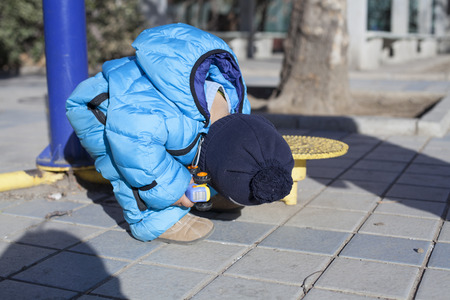 12 18 months: Cute Chinese baby boy studying a training equipment outdoors, shot in Beijing, China