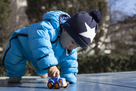 12 18 months: Cute Chinese baby boy playing on a table tennis table, shot in Beijing, China Stock Photo